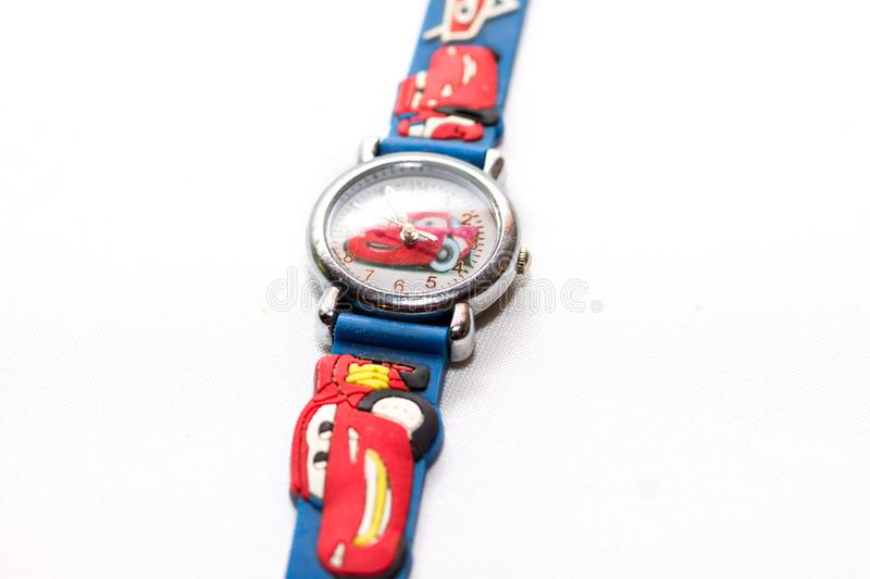 Blue-and-red kids watch cartoon cars with toy cars stock images