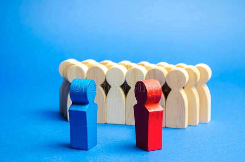Blue and red people stand in front of a crowd. Conflict of interest concept. Two opponents. Dispute. Search for compromises. Social problems. Business royalty free stock photography