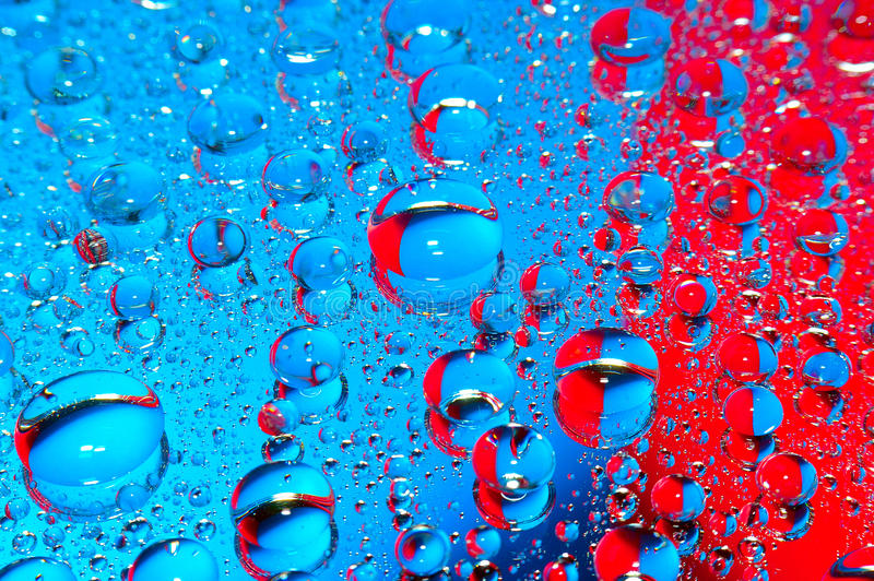 Blue and red pill. Large blue and red drops stock photography