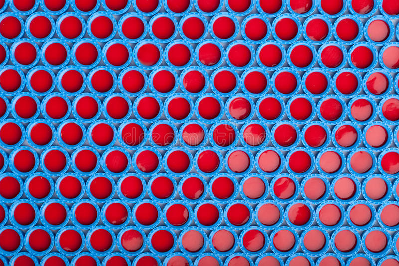 Blue and red plastic caps background stock photos