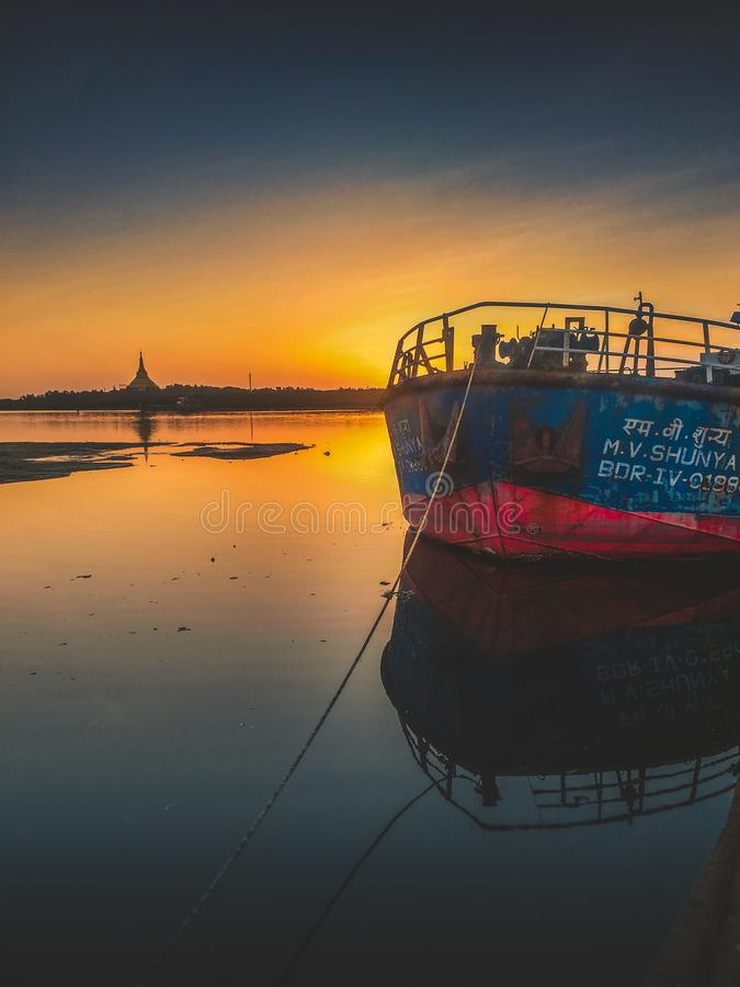 Blue and Red Ship during Golden Hour royalty free stock photos