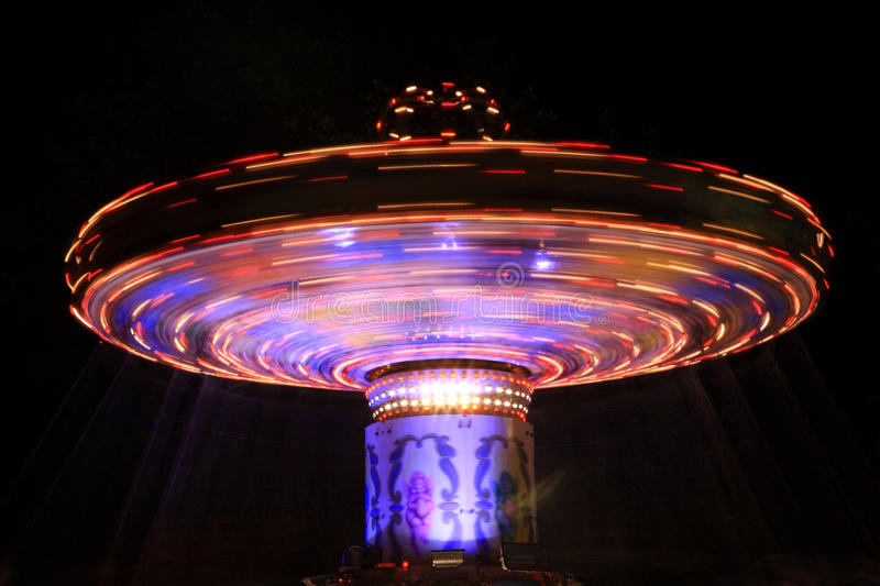 Blue and red spinning carousel royalty free stock image
