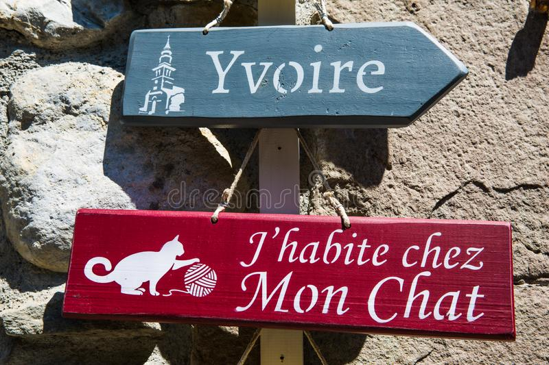Blue and Red Wooden Direction Sign to Yvoire Town in French royalty free stock images