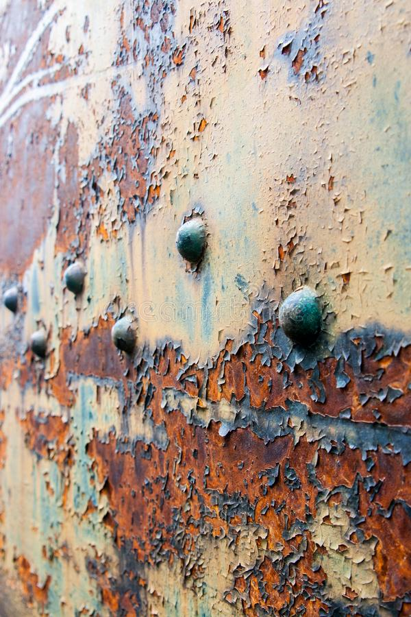 Blue red and yellow rust on bolted train car. Old rustic color stock images