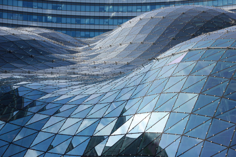 Blue reflections on the roof of modern building. Warsaw. Poland. Modern architecture in Marszalkowska (Marshall street), one of the main thoroughfares in the stock photo