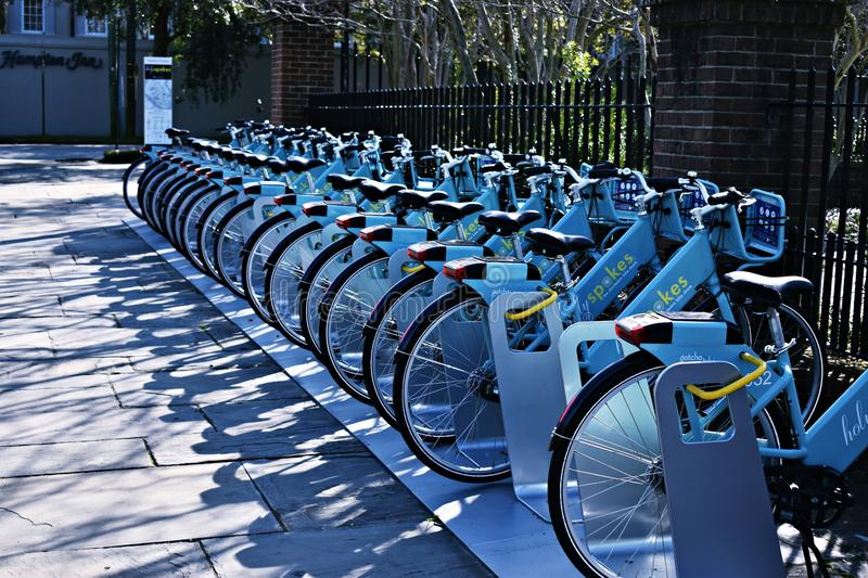 Blue rental bikes royalty free stock photography