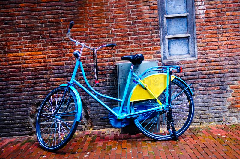 Netherlands Urban Textures, City Blue Retro Bike, Red Brick Wall, Travel Europe, Holland stock photo