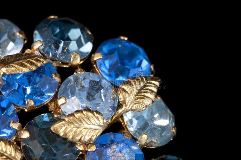Blue rhinestone brooch stock photography