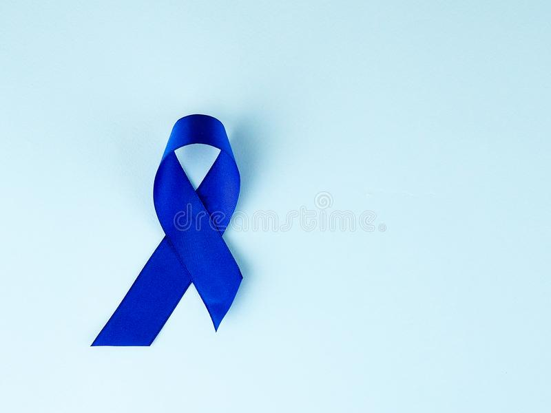 Blue ribbon awareness.Colon Cancer, Colorectal Cancer, Child Abuse awareness, world diabetes day.  royalty free stock photos