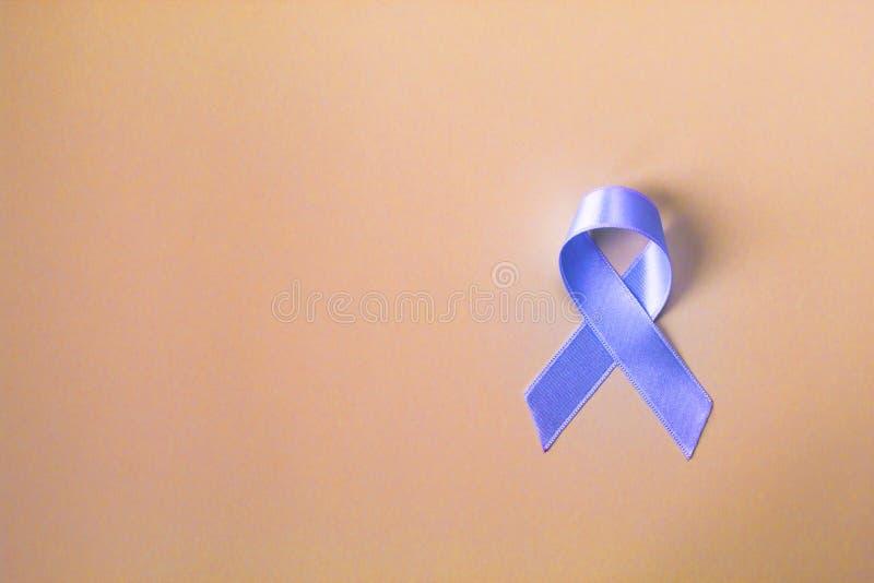 Blue ribbon prostate cancer symbol on pastel background. stock images