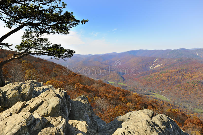 Blue Ridge Mountains View From Ravens Roost. Vista of the Blue Ridge Mountains in Virginia at Fall Peak Color from Ravens Roost, travel destinations for royalty free stock photography