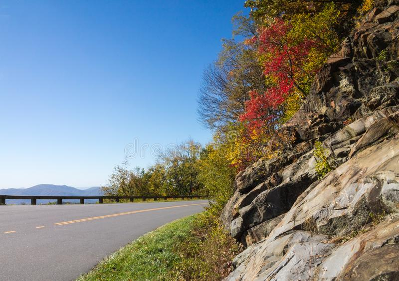 Blue Ridge Parkway mountain view with foliage clinging to the shoulder stock image