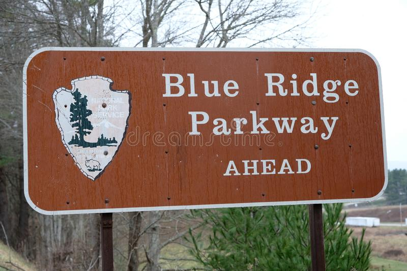 Blue ridge parkway sign on the road in North Carolina mountains stock photography