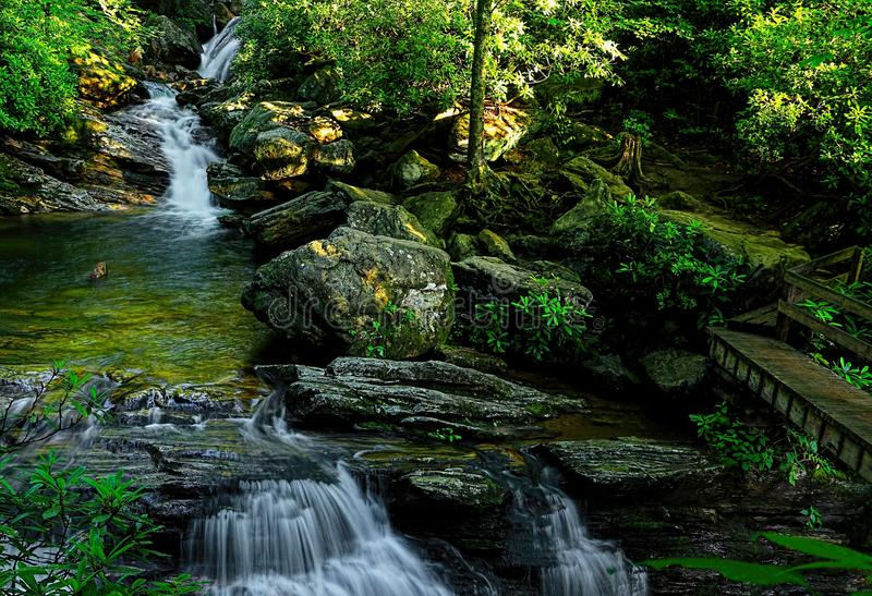 Blue Ridge Parkway Skinny Dip Falls. At mile marker 417 at looking Glass Overlook you cross the Blue Ridge Parkway and follow the trail less than half a mile to stock photography