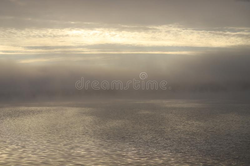 Autumn misty morning by the river,heavy fog stock photography