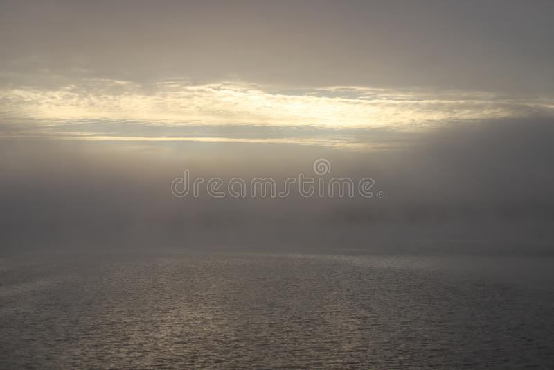 Autumn misty morning by the river,heavy fog stock photos