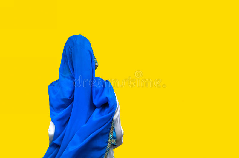 Blue robe. Against yellow background royalty free stock image