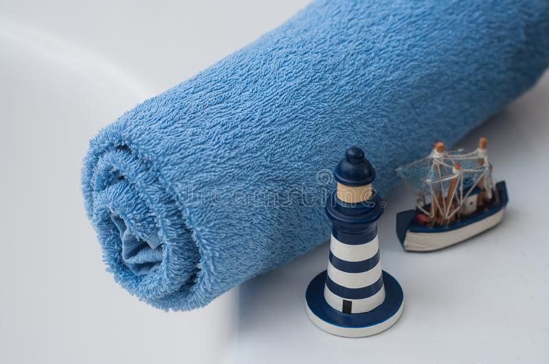Blue rolled bath towel with ocean decoration in bathr royalty free stock photography