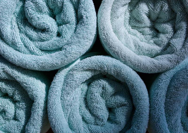 Blue Rolled towels in hotel. Near swimming pool stock images