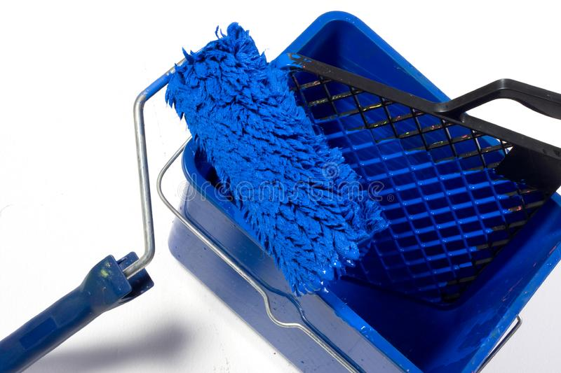 Blue roller brush, bucket royalty free stock photography