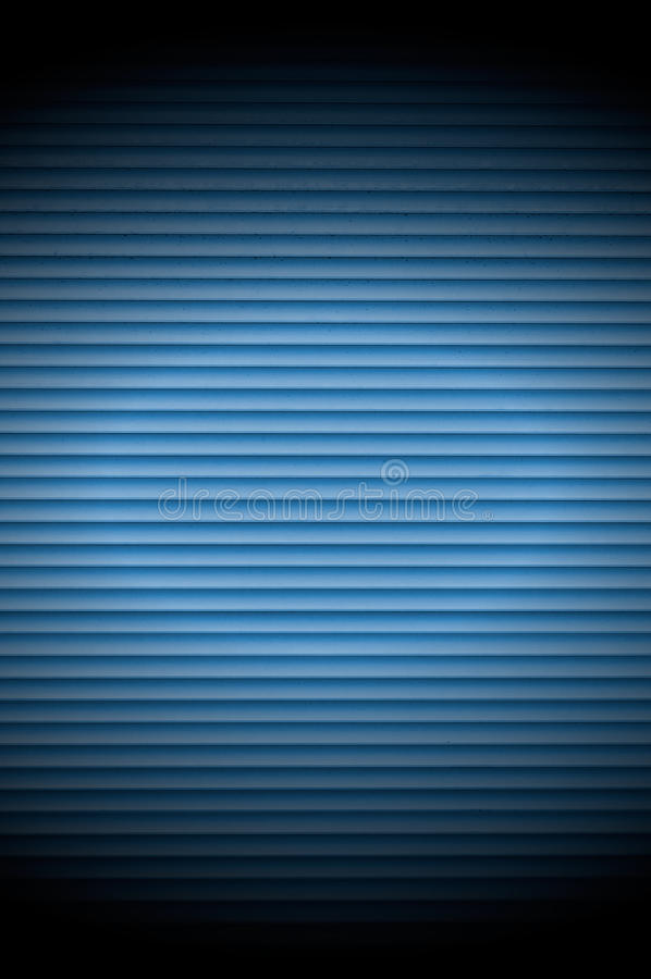 Blue Roller Shutter Background with Spotlight. A blue roller shutter door with spotlight as a background stock images