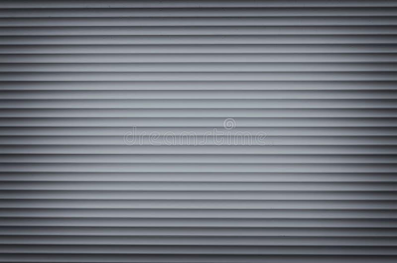 Blue Roller Shutter Background. A spotlit roller shutter door as a background royalty free stock photo