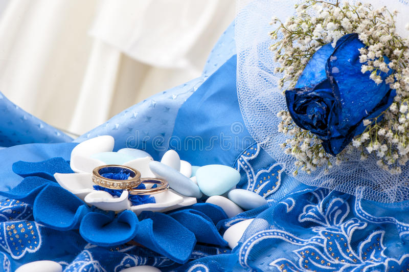 A Blue Roses And Wedding Rings Stock Image Image Of