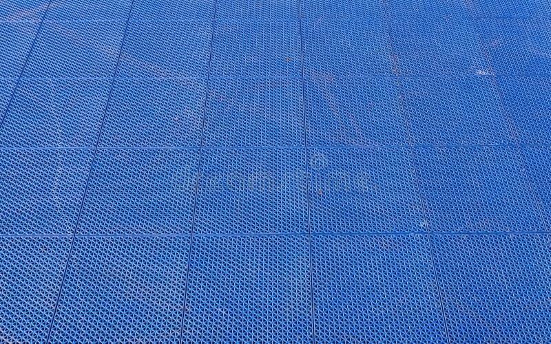 Blue Rubber Flooring On Futsal Field Background Natural Light