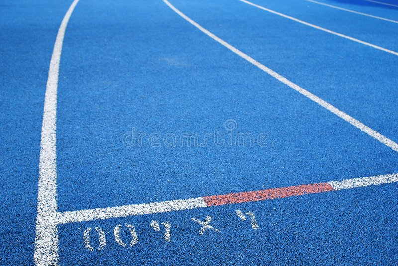 Blue running track royalty free stock image