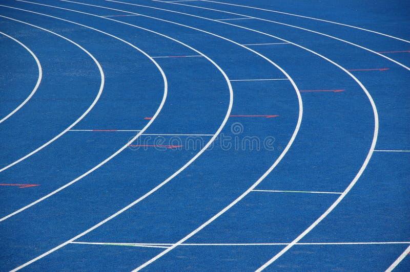 Blue running track stock image