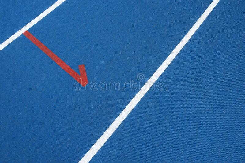 Sport background. Blue running track with white lines and red mark in sport stadium. Top view. Blue running track with white lines and red mark in sport stadium royalty free stock image
