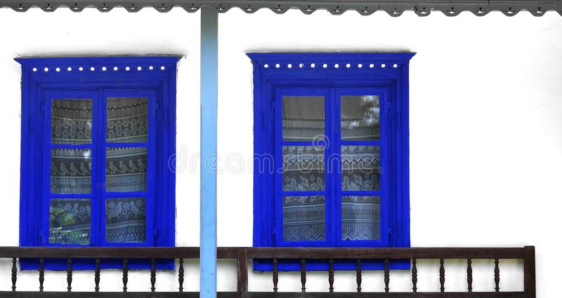 Blue rustic traditional windows royalty free stock photography