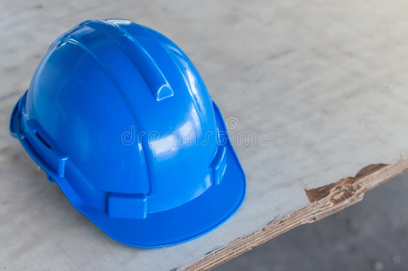 The blue safety helmet at construction site royalty free stock photography