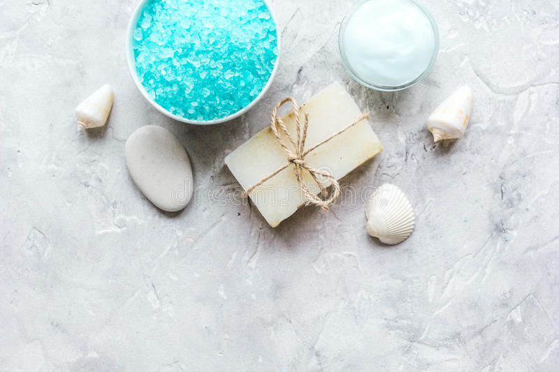 Blue salt, body cream and shells for spa bath background top view mockup stock photography
