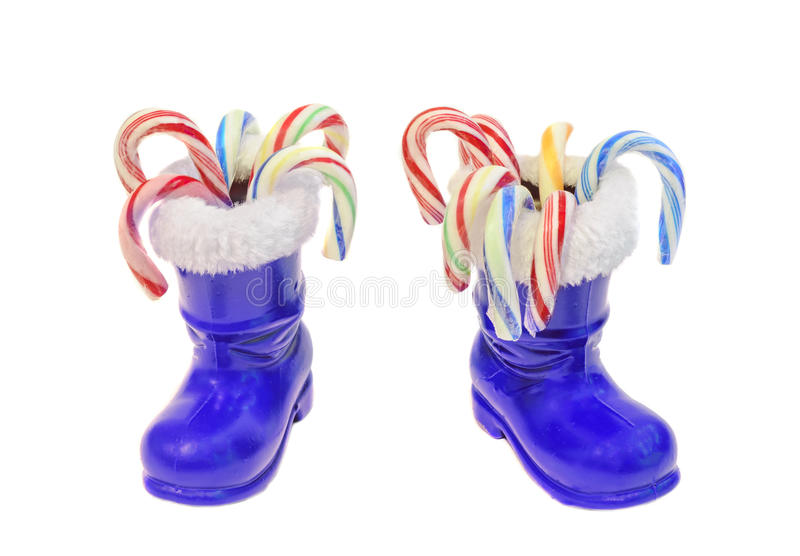 Blue Santa Claus boots, Saint Nicholas, with colored candies bars. Isolated on white background stock photo
