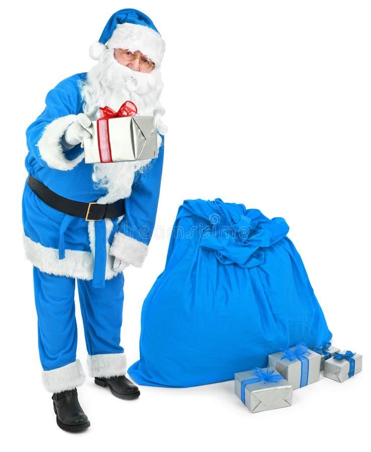 Blue Santa gives a present stock photos