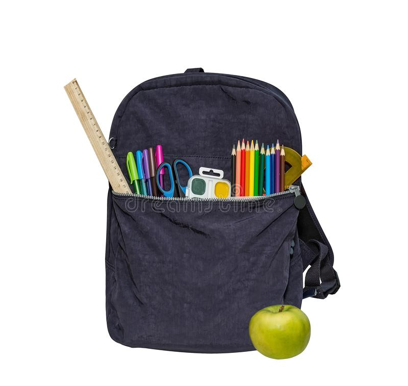 Blue school bag Contains watercolor ruler color pencils,. Blue school bag, backpack and apple. Contains watercolor, ruler, color pencils, protractor, scissors stock images