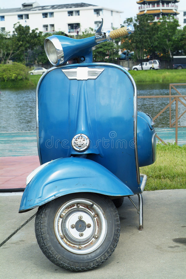 Blue scooter. Classic, Italian, blue scooter parked stock image