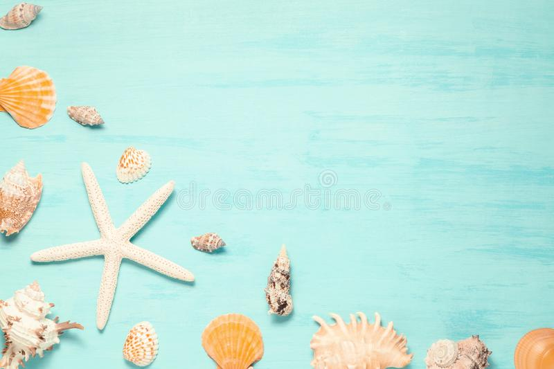 Blue sea background with copy space and seashell border, summer holiday and vacation concept.  stock images