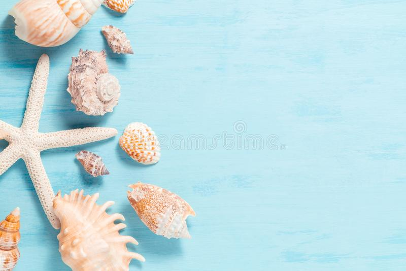 Blue sea background with copy space and seashell border, summer holiday and vacation concept.  stock photos