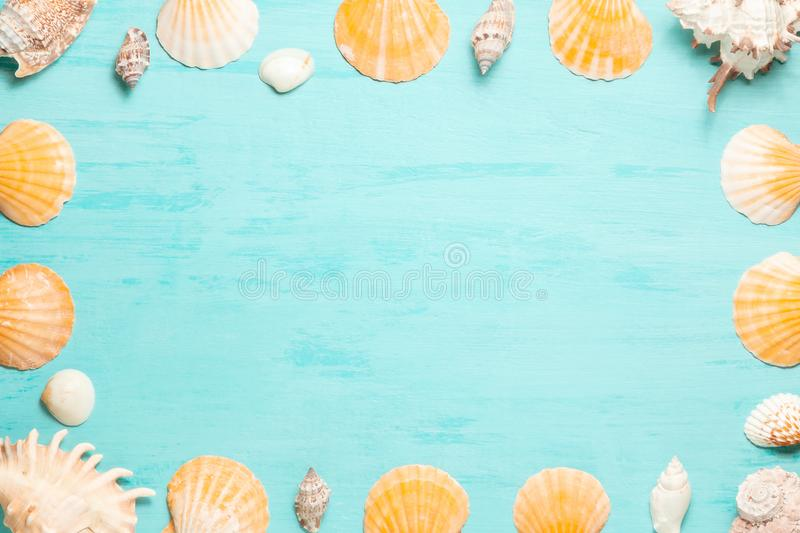 Blue sea background with copy space and seashell border, summer holiday and vacation concept.  royalty free stock photo