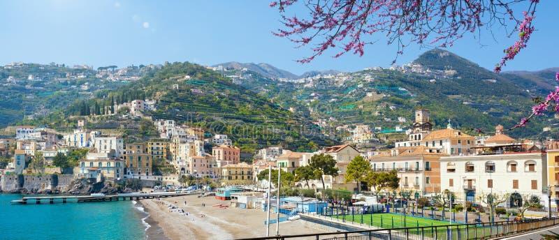 Blue sea and beach in Minori, attractive seaside town of Amalfi Coast, province of Salerno, in Campania region of Italy. Welcome to Minori panoramic concept stock photo