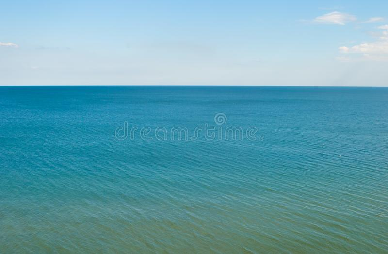 Blue Sea, calm, horizon line and the brigt sky. Blue Sea, calm, horizon line with the brigt sky in the background stock photos