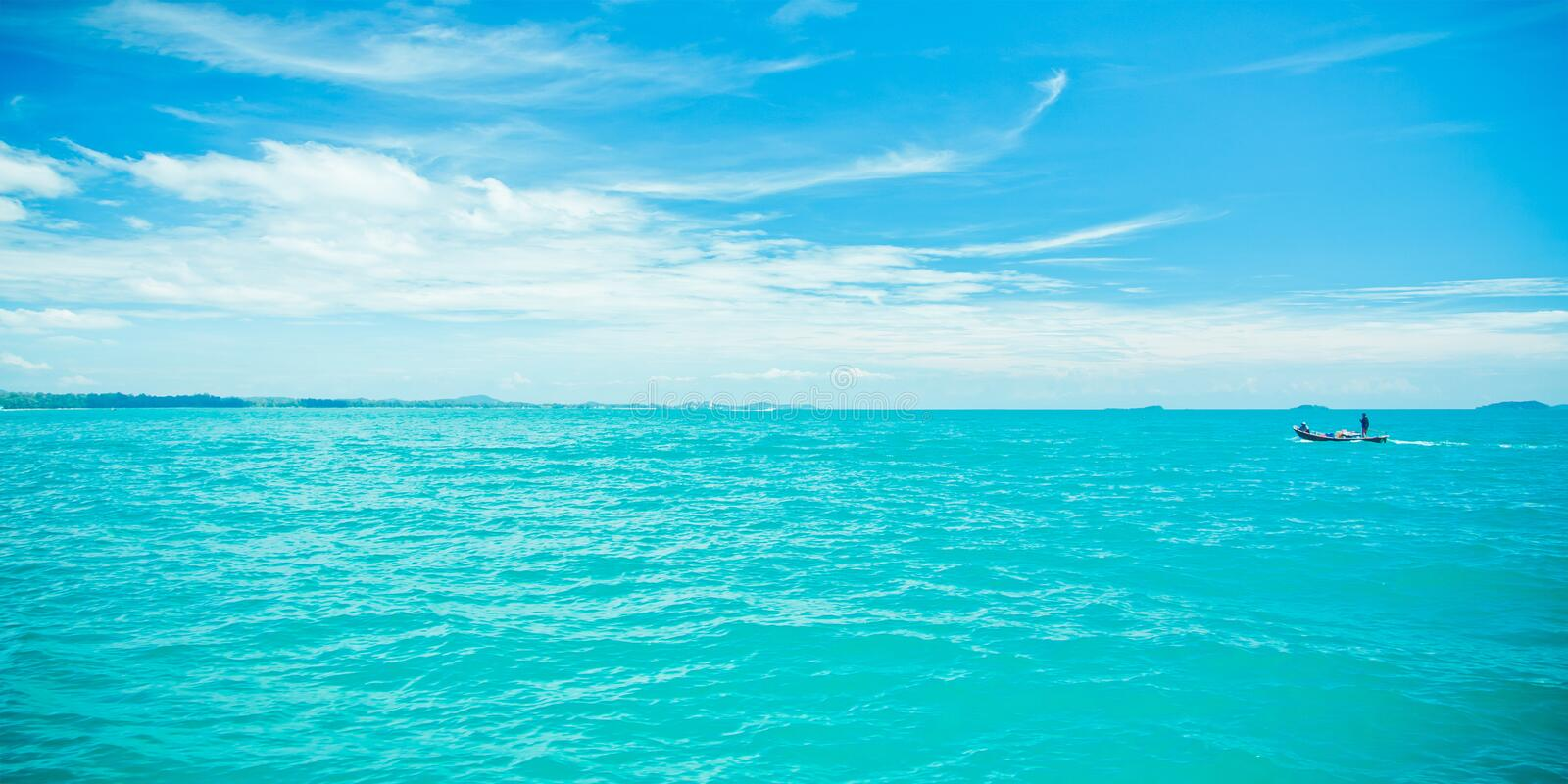 Blue sea and clouds royalty free stock images