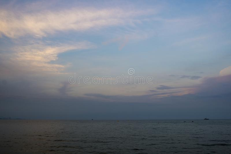 Blue sea and clouds on sky with water surface and sunlight reflections stock photo