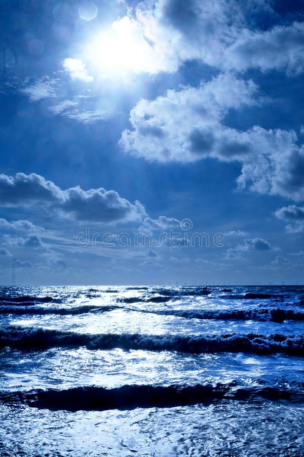 A blue sea glistening white royalty free stock images