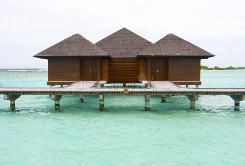 Blue sea and holiday chalets. Holiday chalets, Paradise Island, Maldives royalty free stock image