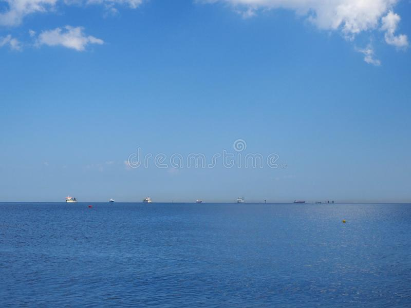 Blue sea horizon line with ships - landscape layout royalty free stock photos