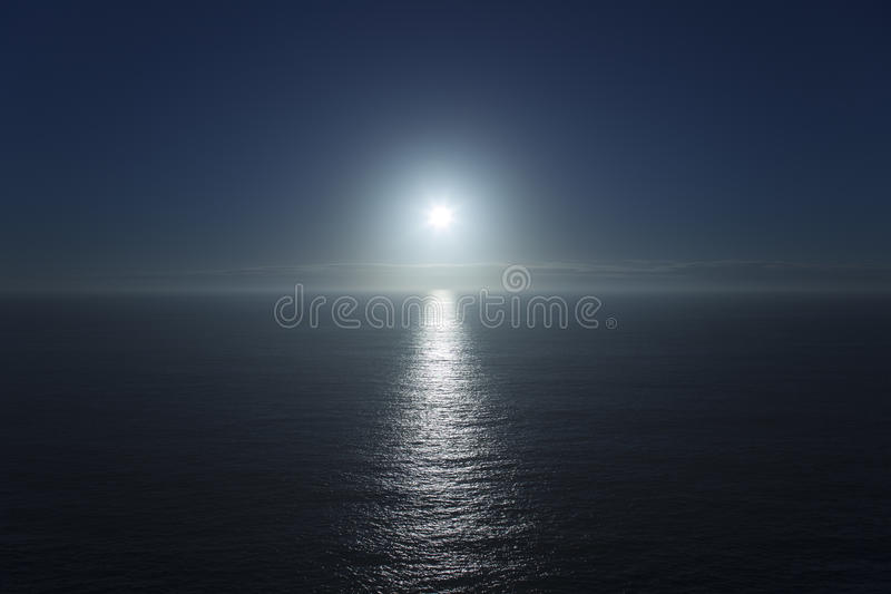 Blue sea horizon and sun stock images