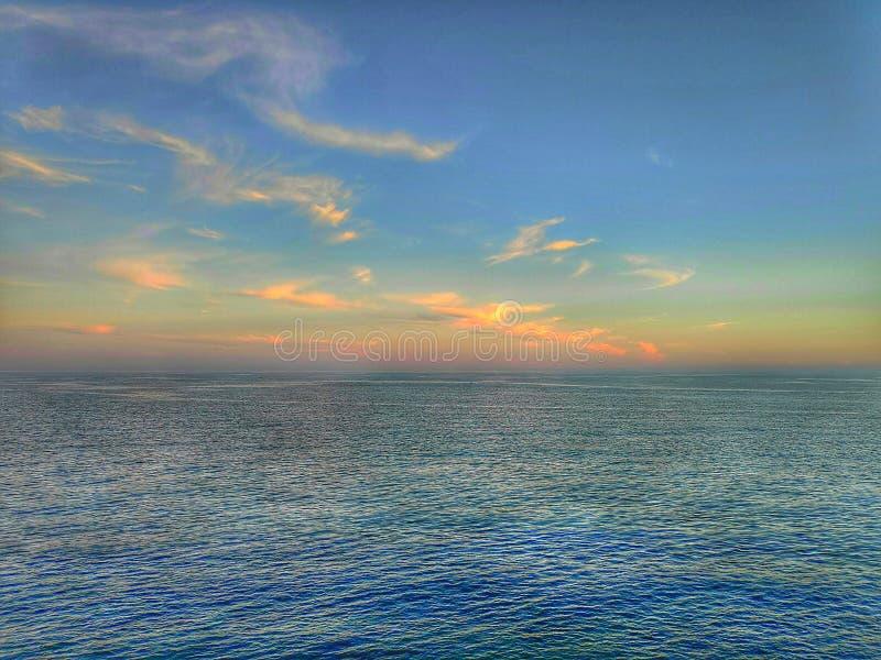 Blue sea horizon at sunset royalty free stock photography